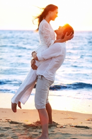 Man and woman embracing at beach 2